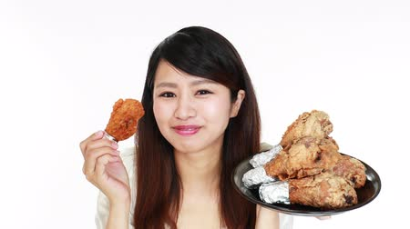 sponka : Woman eating delicious fried chicken