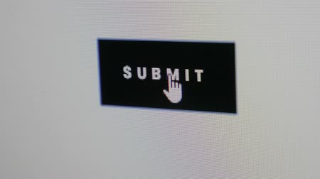 kursor : Close up Shot of Mouse Cursor Clicking black SUBMIT Button.