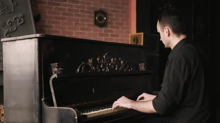 Close up view of pianist playing the piano in an old-fashioned house. Dostupné videozáznamy