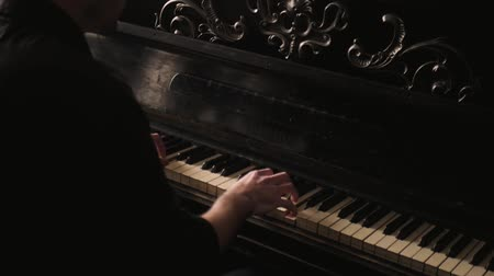 compositor : Pianist passionately playing the vintage piano in old-fashioned interior.