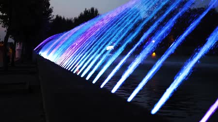 Night colorful city fountain with light effect in the resort city of the city. Ternopil, Ukraine