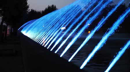 vodopád : Slow motion. Night colorful city fountain with light effect in the resort city of the city. Ternopil, Ukraine