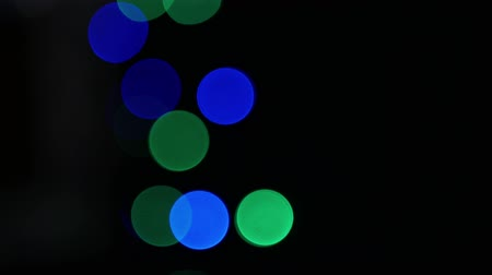 highlights : Red, green and blue bokeh with black background Stock Footage