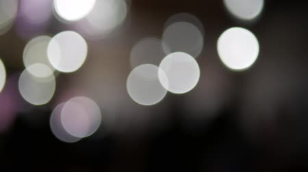 Blurred black and white lights bokeh. People dancing. Party concept.