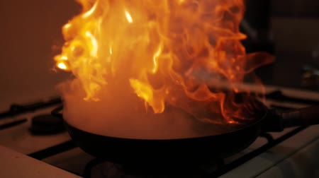 saute : Cooking in wok pan with hard fire burning in slow motion Stock Footage