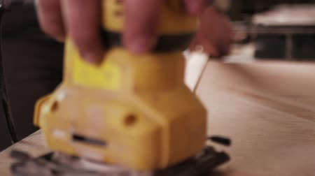 sander : Panoramic close shooting of manual grinding process in carpenters hand. Stock Footage