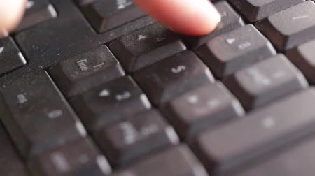 searches : Finger typing on dirty keyboard Stock Footage