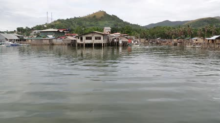 críquete : in the philippines coron antique stilts house for poor people dirty and boat near water