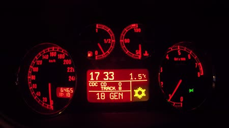 kilometer : in a car dashboard in the night red light and speed concept
