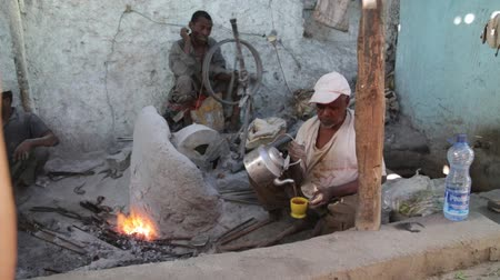 ethiopia : ETHIOPIA, HARAR-CIRCA DECEMBER 2017 - unidentified people working the metal in the forge