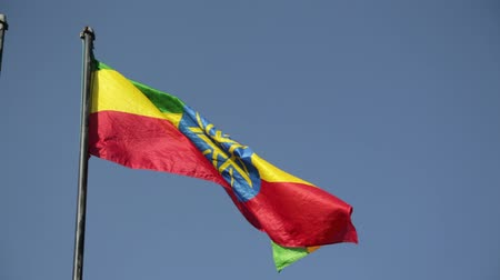 antique grunge : in ethiopia africa the colorful flag waving in the sky