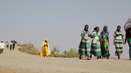 epiphany : ETHIOPIA, TIGRAY-CIRCA JANUARY 2018 - unidentified people walking to lalibela for the genna celebration Stock Footage