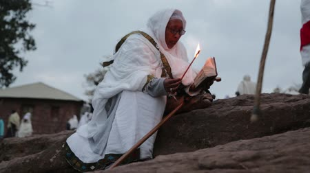 hacı : ETHIOPIA, LALIBELA-CIRCA JANUARY 2018 - unidentified people in the genna celebration Stok Video