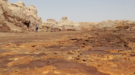 chloride : ETHIOPIA, DALLOL-CIRCA DECEMBER 2017 - Unidentified people walking in the volcanic depression