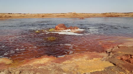 dallol : the black lake with boiling oil and hot Stock Footage