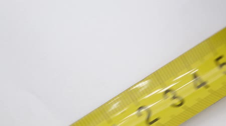 polegada : blur yellow tape measure in white light like concept of diet and utensil and copy space