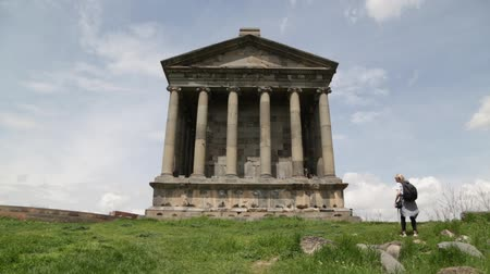 pohanský : ARMENIA, GARNI-CIRCA MAY 2019 - unidentified people near the antique temple