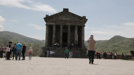 kutsal : ARMENIA, GARNI-CIRCA MAY 2019 - unidentified people near the antique temple