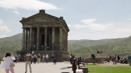 монастырь : ARMENIA, GARNI-CIRCA MAY 2019 - unidentified people near the antique temple