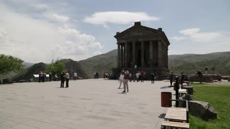 dinastia : ARMENIA, GARNI-CIRCA MAY 2019 - unidentified people near the antique temple
