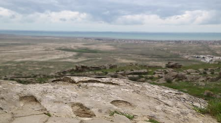 qobustan : in azerbaijan gobustan the antique prehistorical cave Stock Footage
