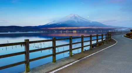 japan : Timelapse of Moonset and Sunrise over Mt. Fuji at Yamanaka lake, Yamanashi, Japan 4K UHD