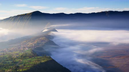 time flow : 4K Timelapse of morning mist at Cemoro Lawang village near Bromo volcano, Indonesia