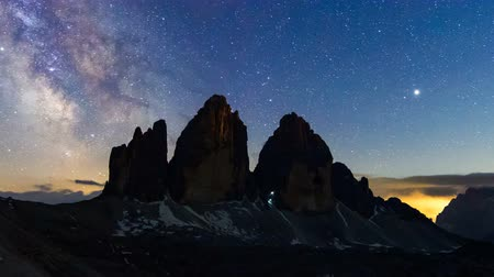 tre : 4K Timelapse of Milky way over Tre Cime di Lavaredo, Dolomites, Italy Stock Footage