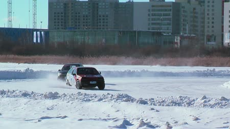 взял : Tyumen, Russia - February 22, 2015: Ice cult sports track on Alebashevo lake. Sports competitions on cars. Sportsman didnot fit into turn and took off from track