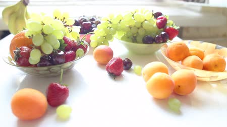 different Summer fruits and berries on a table, dolly shot, Full HD