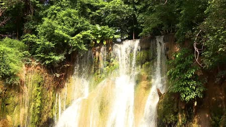 Waterfall at Kwai Noi river. Beautiful green forest. Sai Yok National Park, Kanchanaburi, Thailand. Travel to Asia.