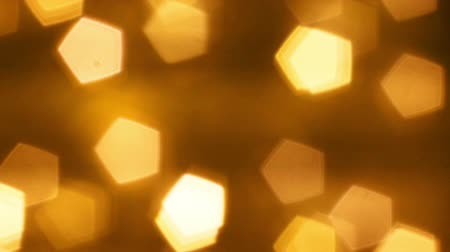 Defocused Bokeh lights HD stock footage. Twinkling christmas decoration. Abstract background animation for a subtle backdrop, ideal for title overlays. Seamless loop glowing gold lightbulbs out of focus. Wideo