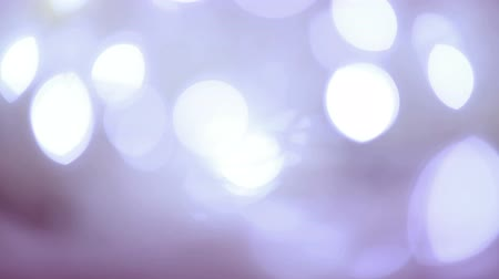 Defocused Bokeh lights HD stock footage. Twinkling christmas decoration. Abstract background animation for a subtle backdrop, ideal for title overlays. Seamless loop glowing violet lightbulbs out of focus. Wideo