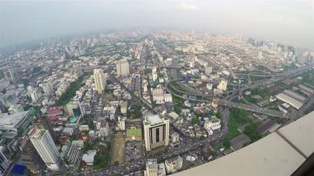 observation deck : BANGKOK (Krung Thep Maha Nakhon) , THAILAND - November 15, 2017: View from the observation deck of the tallest skyscraper. Asian city. Modern hotels and business centers. Car traffic on the roads. Wide angle 4k video