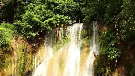 Waterfall at Kwae Noi river. Beautiful green forest. Sai Yok National Park, Kanchanaburi, Thailand. Travel to Asia.