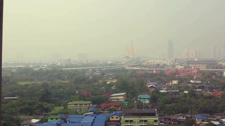 phraya : View of Bangkok, Thailand. Residential houses, traffic junctions and a large bridge across the Chao Phraya River. Stock Footage