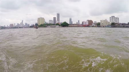 habitable : BANGKOK, THAILAND- November 15, 2017: View of the city from the boat. The journey on the Chao Phraya river. The high-rise houses in the city. Traditional water transport. Travel in Asia. High building. Stock Footage