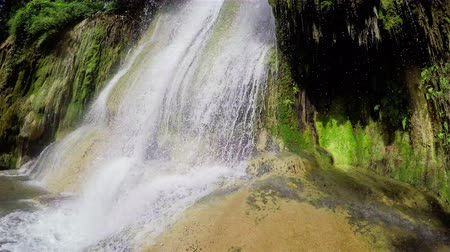 Waterfall close-up at Kwae Noi river. Sai Yok National Park, Kanchanaburi, Thailand. Travel to Asia.