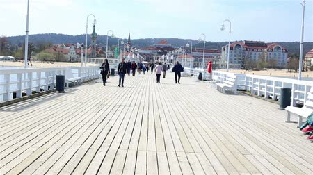 túmulo : Sopot, Poland - April 20, 2018: tourists at the Pier in Sopot (Sopockie Molo). Famous polish touristic attraction