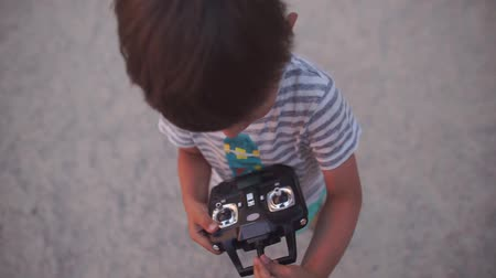 unmanned aircraft : the boy holds control in the yard of the house for 4 years
