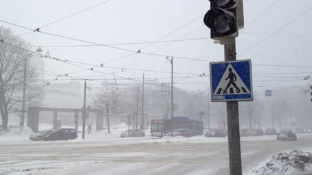 trave : HELSINKI, FINLAND - JANUARY 2012: Snowfall in a city at winter