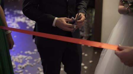 cutting open : Cutting red ribbon on wedding party opening
