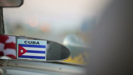 kübalı : Rear mirror in old car with cuba flag Stok Video