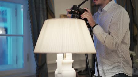 videocamera : Man working with camera on tripod indoors Stock Footage