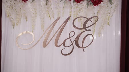 sziám : M and E sign on a wedding party on white cloth background