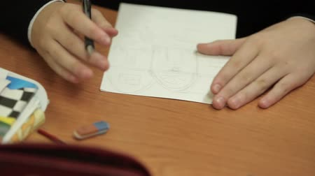 borracha : Pupil drawing house on paper in class Stock Footage