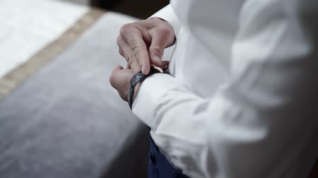 pansuman : Man wearing wrist watch shot