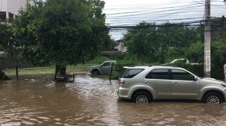 floods : KOH SAMUI, THAILAND, JANUARY 10, 2017: Flood on circle road cars in water