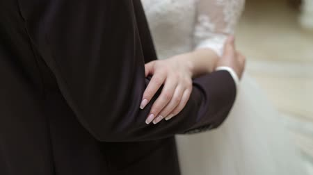 classical suit : Young wedding couple embracing indoors Stock Footage