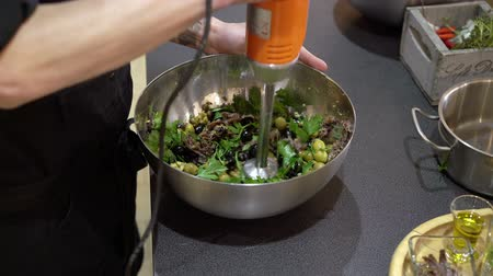 kitchen blender : Cook mixing salad with blender